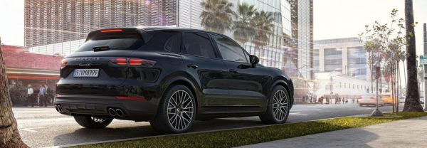 black 2019 Porsche Cayenne parked on city street
